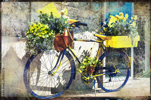 Spoed Foto op Canvas Fiets vintage bike decorated with flowers, artistic retro picture