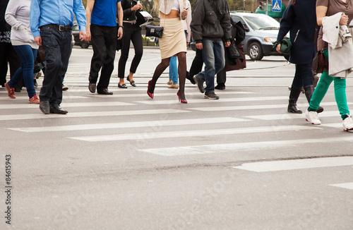 legs of pedestrians on a pedestrian crossing Fototapet
