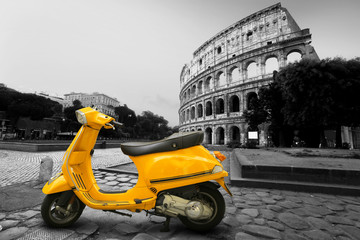 Fototapeta Motor Yellow vintage scooter on the background of Coliseum