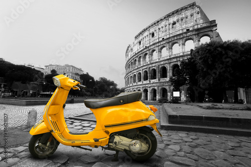 Fotografering  Yellow vintage scooter on the background of Coliseum