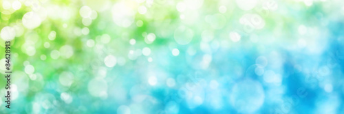 Defocused highlights in green and blue, panorama format Wallpaper Mural