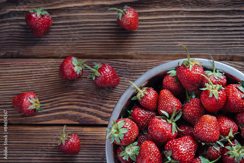 Fresh fruit of strawberries on old wooden table Poster