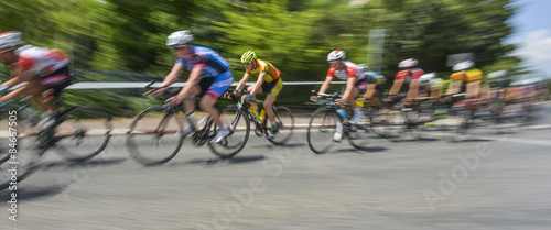 Fotografie, Obraz  peloton of bicycle riders in a race in motion
