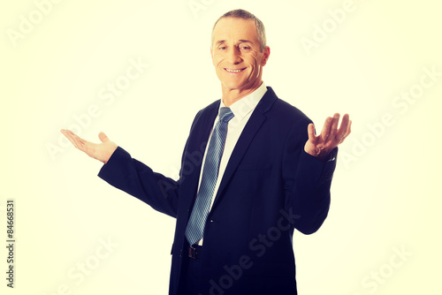 Deurstickers Ontspanning Businessman with open hands in undecided gesture