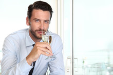 Beautiful Man Drinking Champagne With Intriguing Look And Haught
