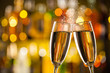 canvas print picture - Glasses of champagne with blur background