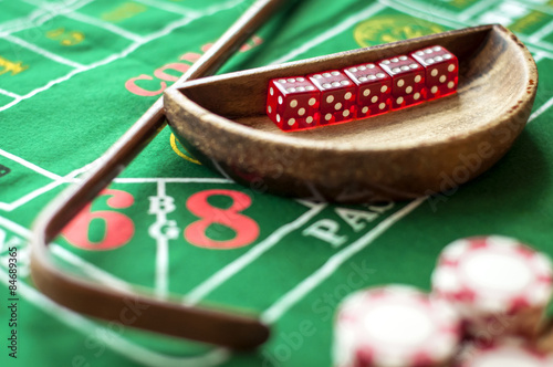 5 Dice in a bowl and a stick on a craps table Canvas Print