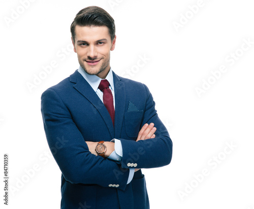 Photo  Happy young confident businessman with arms folded isolated on a white background