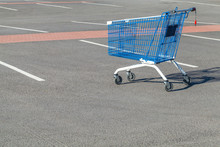 Empty Shopping Cart Stands On A Parking