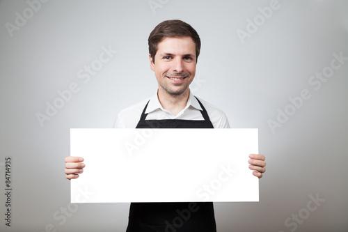 Tableau sur Toile mann mit schürze und schild