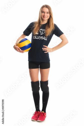 Fotografiet  Mädchen im Trikot hält einen Volleyball