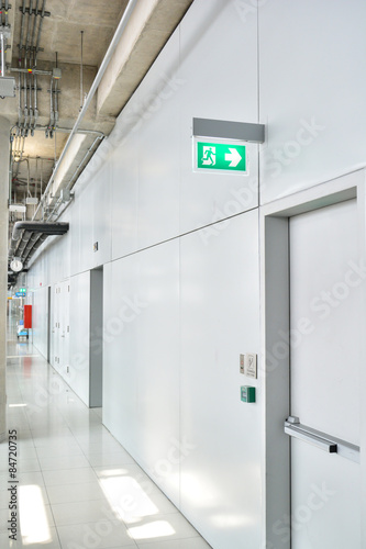 Fire exit sign in factory Fototapeta