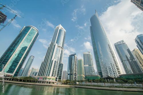 Canvas Prints Light pink Tall skyscrapers in Dubai near water