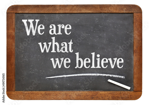 We are what believe on balckboard Canvas Print