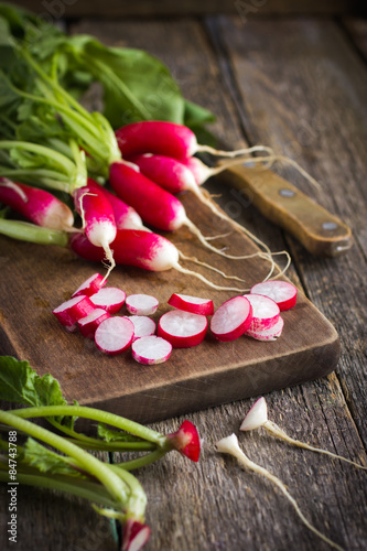 fresh organic radish on cutting board Poster