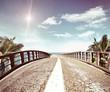 Asphalt road along a tropical sea