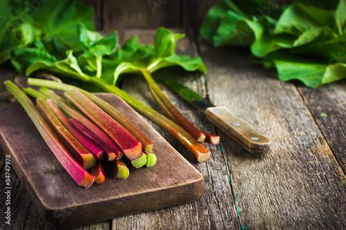 fresh organic rhubarb on cutting board Canvas Print