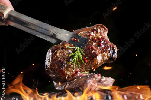 Fotografering Beef steak on grill