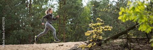 Fotografie, Obraz  Trail running in the forest