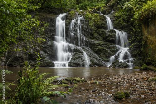 Keuken foto achterwand Watervallen River falling over a waterfall on the mountain.