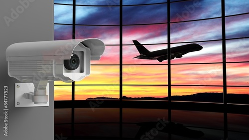 In de dag Luchthaven Security surveillance camera with airport window as background