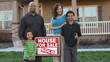 Happy African American family buy a house