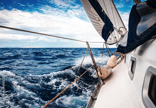 Fotografia, Obraz  The white sails of yachts on the background of sea and sky in the clouds