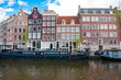 Amsterdam cityscape with houseboats along the canal, Netherlands.