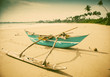 Untouched tropical beach with fishing boat in Sri Lanka