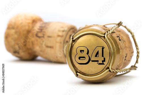 Poster  Champagnerkorken Jubiläum 84 Jahre