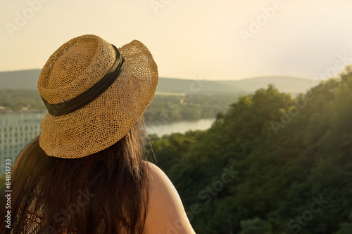 Fotografía  Woman Standing at Balcony Looking to Distance in Sunset