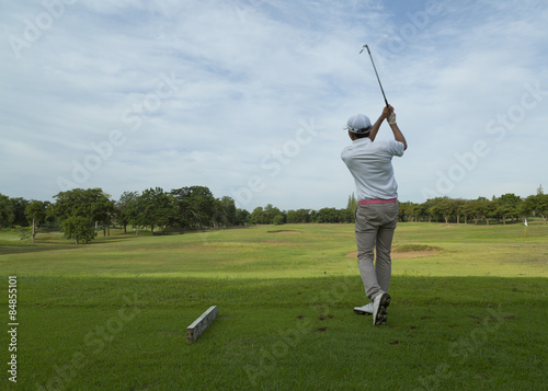 widely golf  course in very nice day in summer with player - 84855101