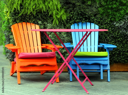 Brightly painted garden furniture - Buy this stock photo and ...