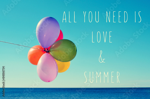 Photo  balloons on the sea and text all you need is love and summer