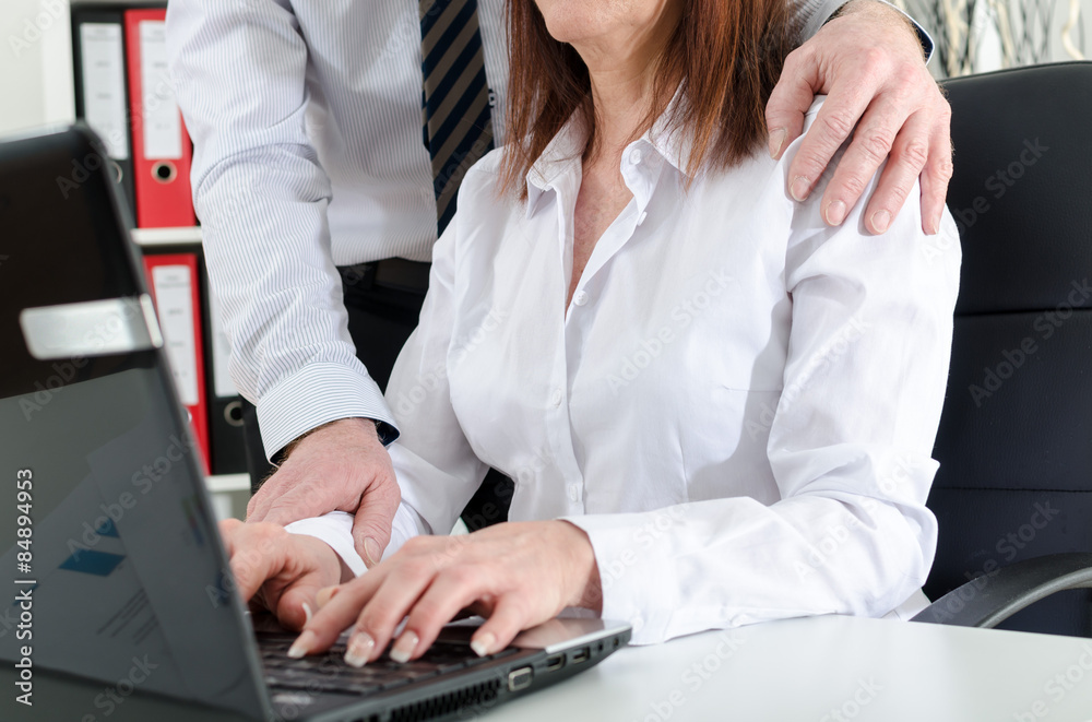 Fototapety, obrazy: Manager putting his hand on the shoulder of his secretary