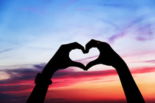 Heart Shape Of Hands Against The Sky
