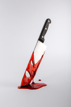 Blood Drenched Kitchen Knife In Pool Of Blood