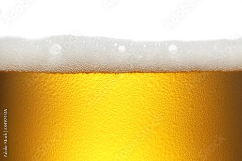 ビール/ビールのクローズアップでテクスチャーを強調しています。