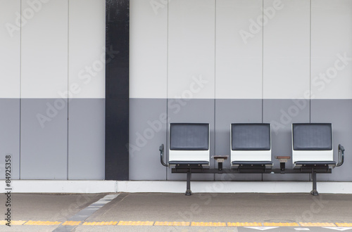 Aluminium Prints Train Station Outdoor empty passenger seat at train station