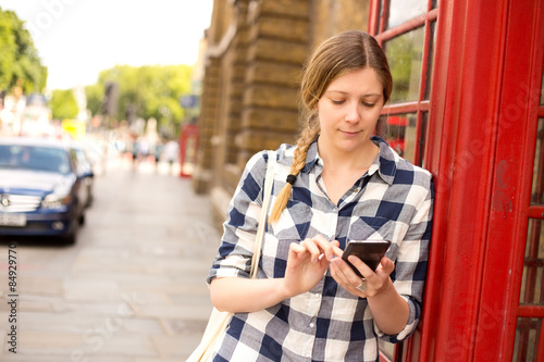 young woman sending a text in london Canvas Print