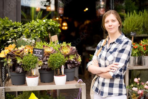 business woman standing outside her flower shop