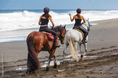 Spoed Foto op Canvas Paardrijden promenade à cheval sur la plage de l'Etang-Salé, Réunion