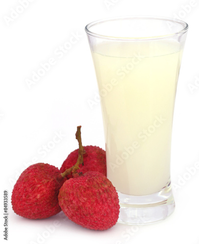 Lychee juice with fruits over