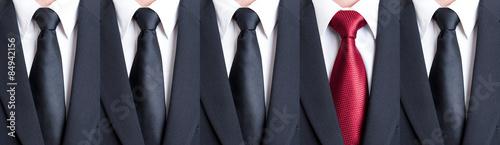 Fototapeta Red tie between black neckties obraz