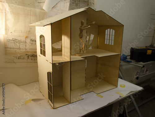 Photo  Dollhouse and drawings of the project