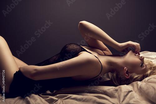 Fotografie, Obraz  Sensual blonde woman posing in dark sexy lingerie.