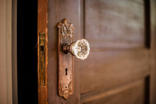 Wooded Door With Antique Door Knob.