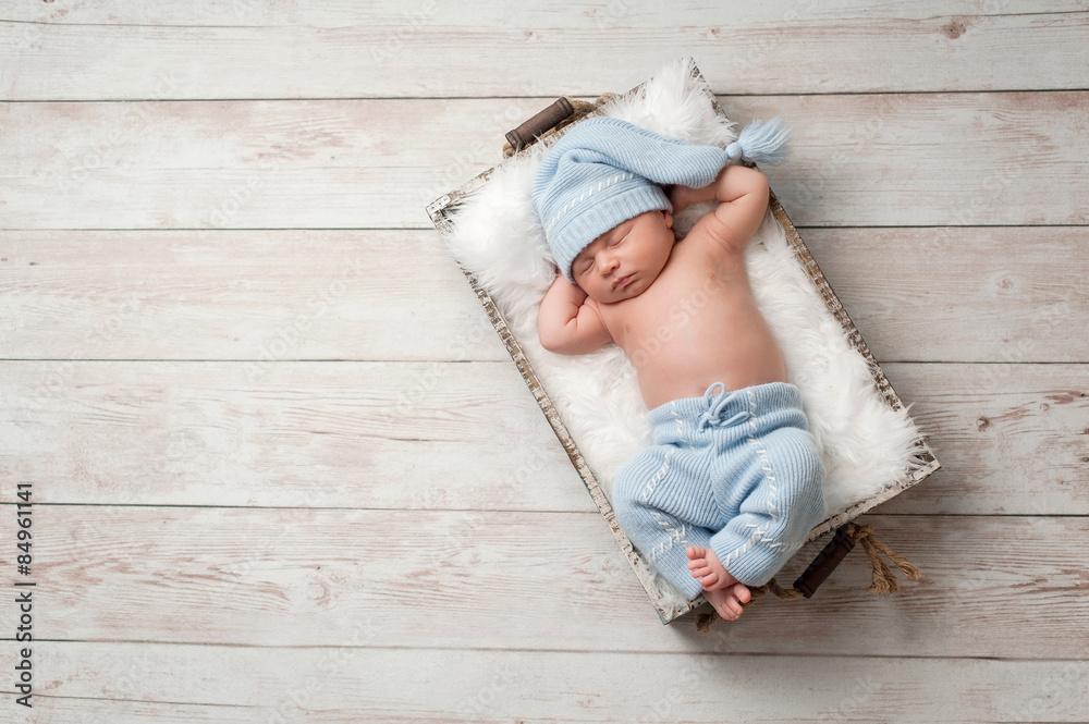 Photo  Sleeping Newborn Baby Wearing Pajamas