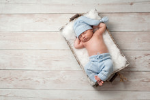 Sleeping Newborn Baby Wearing ...