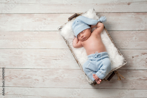 Sleeping Newborn Baby Wearing Pajamas Fototapet